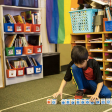 NYTimes image of child playing with digitally enhanced sequencing blocks